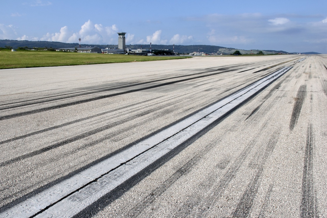 'Concrete runway of Split airport with traces of airplane wheels' - Spalato